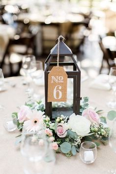 vintage lantern wedding centerpiece with burlap table number