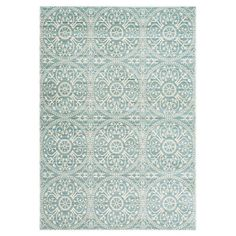 Lend a pop of pattern to the den or master suite with this stylish rug, showcasing a medallion motif in alpine and cream.  Product: ...