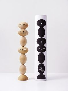 TOTO Wooden stacking puzzle with cute faces.