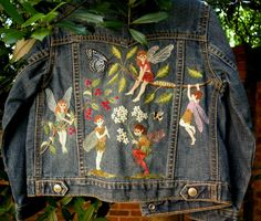 Surface Hand Embroidery on Denim Jacket by Catherine Ronan for a two year old child.