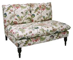 Resting on finely crafted spindle legs and upholstered in a classic floral pattern, this sleek armless settee will add a dash of sophistication to the room. Handcrafted in the USA.