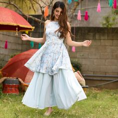 "Be the new uber chic this summer season by flaunting in our ""powder blue set"". The soft and flary pants with the floral print of the season… Pakistani Dresses Casual, Indian Gowns Dresses, Indian Fashion Dresses, Dress Indian Style, Pakistani Dress Design, Girls Fashion Clothes, Indian Designer Outfits, Stylish Dresses For Girls, Stylish Dress Designs"