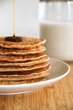 Banana Oat Greek Yogurt Pancakes -- Quick and easy gluten-free pancakes made from oats, banana, and Greek yogurt. A simple and nutritious way to start the day.