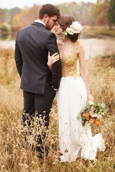 Stunning & romantic fall wedding photo -- that bride's dress is perfect for the season! | http://www.weddingpartyapp.com/blog/2014/11/11/15-romantic-fall-wedding-photos-thatll-convince-fall-wedding/