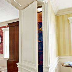 This homeowner carved out a new partition between rooms to hold closets and disguised the doors with raised panels. | Photo: Wendell T. Webber | thisoldhouse.com