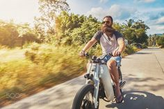 Popular on 500px : driving vintage motorbike fast through country side in thailand by JoshuaResnick