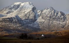 A dusting of snow followed by a sunburst lights up a classic view of Bla Bheinn on Skye  Picture: Max Milligan