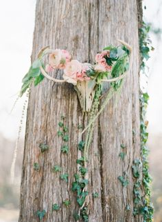Antlers Adorned With Flowers - such a whimsical wedding decor idea! florals by @Anthomanic photo by @Marta Locklear