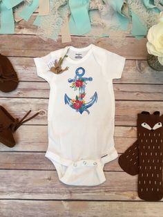 Anchor Onesie® Bodysuit (or t-shirt) Gorgeous baby girl bodysuit or t-shirt with adorable, bright watercolor style anchor with flowers. Perfect for your little boho girl. Show support for our navy / y