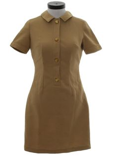 Home Sewn 1970s Vintage Dress: 70s -Home Sewn- Womens tan, textured polyester knit, short sleeve dress, having French and vertical dart shaping. The one-piece fold over collar finishes the round neckline, with a center front shirt band opening, which has four tigers eye gold buttons fastening it. This mini-length garment measures 35in from shoulder to hem.