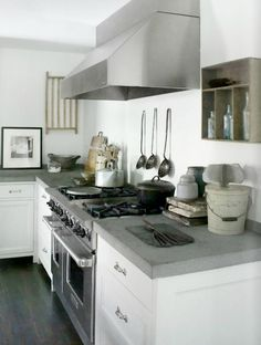 Concrete countertops bring an edgy feel to the somewhat traditional kitchen. For a look at the whole house, see Bridgehampton House. Photo by Robyn Lea for Est Magazine.