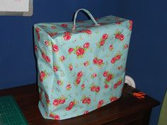 Sewing machine cover with oilcloth.