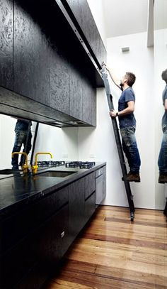OSB cabinets painted black - super cool option for custom on a budget.