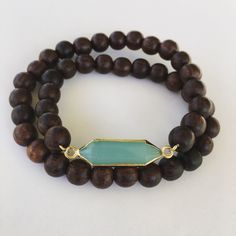 A personal favorite from my Etsy shop https://www.etsy.com/listing/277041090/jade-and-doublewrap-wood-bracelet