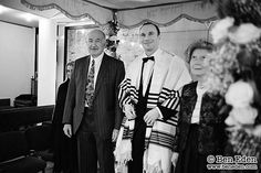 Groom standing under the Chuppah with his parents