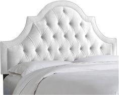 A One Kings Lane exclusive: Pairing a high-arching frame with white velvet upholstery, this tufted headboard makes a dreamy addition to any bedroom. We love how its generous padding offers soft, structured support for watching TV or reading in bed. Attaches to any standard bed frame. Handcrafted in the USA. Furniture > Beds & Headboards > Headboards.