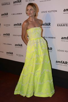 Candice Swanepoel in neon Valentino at the amFAR gala in Sao Paulo, Brazil. via StyleList | http://aol.it/1s6LPGN