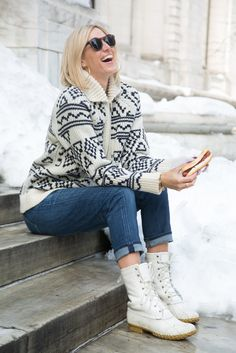 Winter outfit idea - snow boots don't have to be frumpy! Click through for more on this cozy winter look, featuring a cable knit sweater and winter white boots.