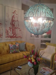 High Point Market Spring 2012-More of the new C.R. Laine Showroom in Yellow/Chartreuse and Aqua.  The Lighting from Currey and Co. and the great artwork from Soicher Marin.