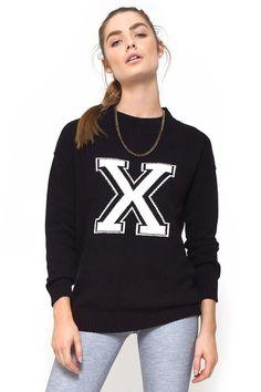 """Se ti piace essere al centro dell'attenzione, è il maglione che fa per te: con il suo logo ad """"X"""" al centro del petto non passerai di sicuro inosservata!"""