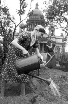 World War II, in Russia – the Great Patriotic War (22 June 1941 – 9 May 1945). During the siege of Leningrad women work in a kitchen garden. It was arranged in the square near St. Isaac's Cathedral. 1942. Photo by V. Kapustin.