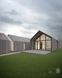 Weathered Cedar cladding on contemporary barn with glass link and glazed gable end with overhang More