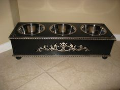 This it a beautiful Custom made Distressed Black Wood Stainless Steel Bowl Pet Dog Elevated Bowl Feeder. Has 3 - 2qt. Stainless Bowls.