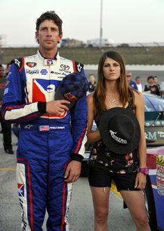 NEWTON, IA - AUGUST 3: Travis Pastrana, driver of the #99 iRacing.com Toyota, and his wife, Lyn-Z Adams Hawkins during pre-race ceremonies before the Pork Be Inspired 150 at Iowa Speedway on August 3, 2012 in Newton, Iowa. (Photo by Rainier Ehrhardt/Getty Images for NASCAR)