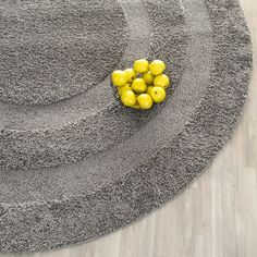 This power-loomed shag rug offers luxurious comfort and unique styling with a raised high-low pile. High-density polypropylene pile features a dark grey background