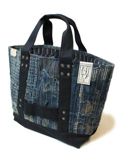 Great use of old denim, even though I am not a natural fan of the whole jeans-into-bag thing' This looks good because of all those straight edges - no hint of the old jeans shape, just the texture.