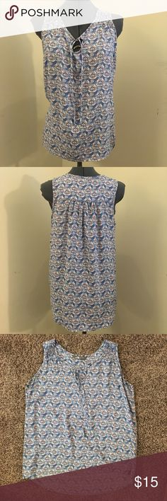"""North Face tank top North Face tank top. Super soft viscose fabric. High low gem, tie detail at neckline. Size medium measures 20"""" across chest 24"""" from shoulder to hem. Like new condition The North Face Tops Tank Tops"""