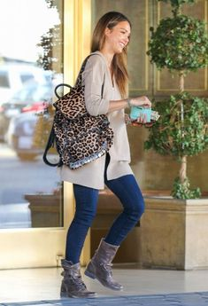 Jessica Alba Casual Style...Blue Jeans + Beige Cardigan + Boots + Cute Leopard Backpack..