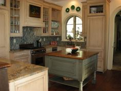Small kitchen? Square island.- I think it's a little too big for the space but it's very pretty.