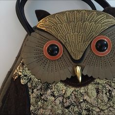 "Vintage Owl Purse Gorgeous gold owl purse with bold orange button eyes, gold beak, and distressed gold & black feathers. Has 2 top handles & strap for crossbody with 2 interior pockets, one zipper pocket & one cellphone pocket. Purchased from vintage boutique in San Francisco. Dimensions:  11"" x 9"" x 3"" Bags"