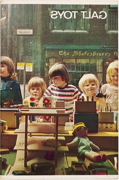 A photograph of children peering into the window of Galt Toys' shop front in Manchester, England, United Kingdom, 1968, photograph by James Galt and Co. Ltd. (photographer unattributed).