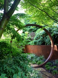 A moon gate and canted retaining wall are fashioned from Cor-Ten in this garden by Davis Dalbok of Living Green and Tim O'Shea of Greenworks Gardens. Cor-Ten, a variant of steel, is becoming increasingly popular in residential landscape design. Modern Landscape Design, Modern Landscaping, Contemporary Landscape, Landscape Architecture, Backyard Landscaping, Landscaping Software, Landscaping Design, Bamboo Landscape, Contemporary Gardens