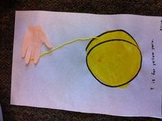 Y is for yellow yoyo. Letter Y art using yellow yarn, die cut hand, and painted circle.