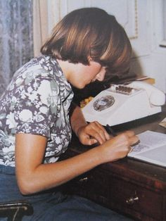 Lady Diana Spencer as a teenager at her desk, before she  was swept into royal duties. Do you ever imagine her life uncrossed by Prince Charles? Enjoy RUSHWORLD boards, DIANA PRINCESS OF WALES EXTENSIVE PHOTO ARCHIVE and UNPREDICTABLE WOMEN HAUTE COUTURE. Follow RUSHWORLD! We're on the hunt for everything you'll love! #PrincessDiana #LadyDiana