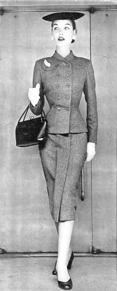 Sherry Nelms in grey wool suit by Handmacher, Vogue, August 1, 1951