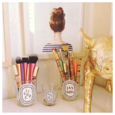 Diptyque jars-- Favorite way to store brushes, pencils and even earrings.