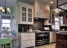 The Black Tin backsplash is a nice contrast to the beautiful cabinets.  Make sure to blend the backsplash with your countertops to provide a seamless look.