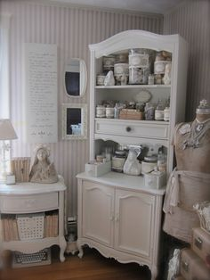 White Painted Cupboard Hutch Cabinet used for Art Craft Supplies at Petite Michelle Louise