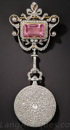 Cartier Diamond Pendant Watch with a Pink Tourmaline Surmount, 1920s.