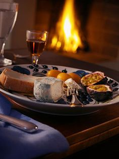 Maxin' the relaxin' - a picnic supper comprising lots of cheese in front of the fire with un verre de vin and some lovin, really, could anything be nicer?