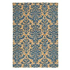 The graphic zebra-skin pattern in Caramel is overlaid with a boldly-scaled, fanciful damask motif in Lapis blue