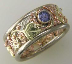 Gold Celtic Ring with Tanzanite