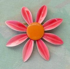 This enameled pin from the has pink and orange enamel and could be either an echinacea or daisy flower. (Looks more like echinacea to me.) It has a inch diameter, and is in excellent vintage condition. The pin will be shipped in a gift box. Vintage Pins, Vintage Brooches, Vintage Jewelry, Floral Pins, Metal Pins, Pink Fashion, Brooch Pin, Daisy, Enamel