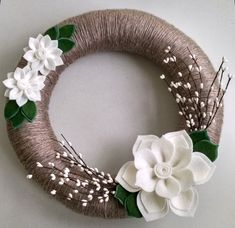 This wreath (shown in 14 inches) is wrapped with a soft two-toned neutral yarn and embellished with white wool felt flowers and berries. Leaves are dark green with a hint of blue spruce. Color customization available.  All flowers are hand cut and made with a sturdy wool felt. (Ribbon for hanging not included)  This wreath is perfect to keep up all year long!  Its the perfect size to hang on any door, mantel, mirror, window pane or in any space that needs a special touch.  I have done my…