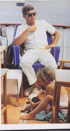 John F. Kennedy sailing with daughter Caroline.