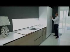 video de cocinas integrales modernas laca brillo con perfil gola y sistema pushto